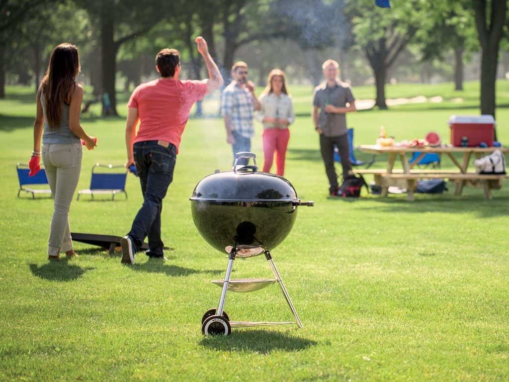 grill in a park with people