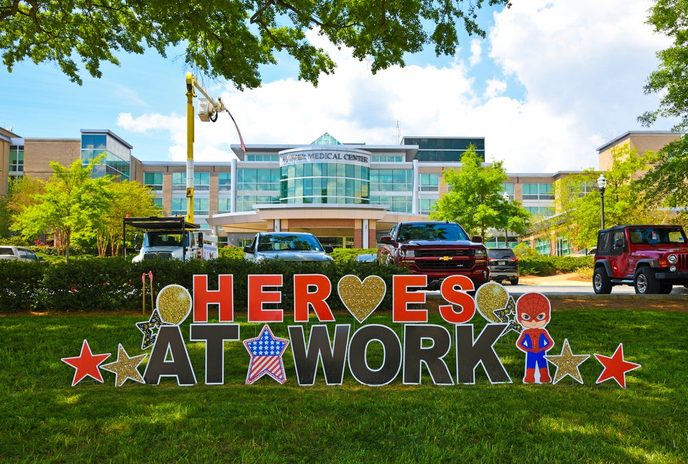 """A """"heroes at work"""" sign in front of the Tanner Medical Center in Carrollton, Georgia, honors the medical staff treating COVID-19 patients."""