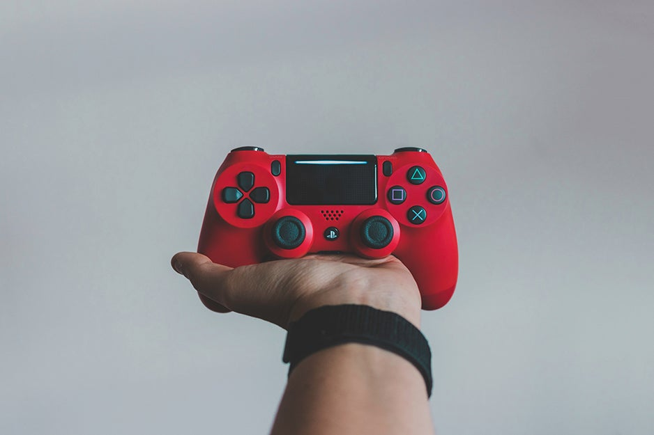 person holding a PS4 controller