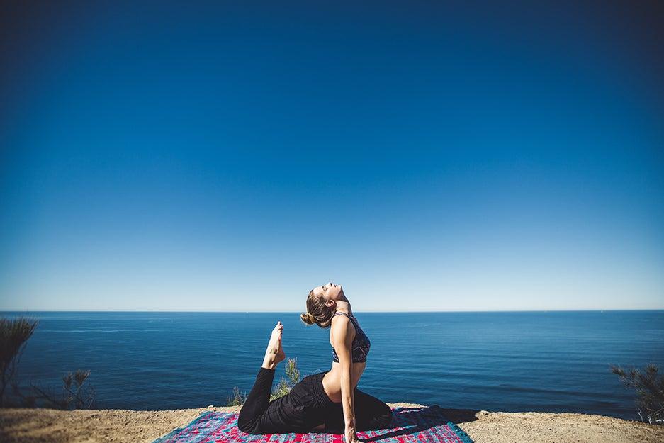 person doing yoga outside