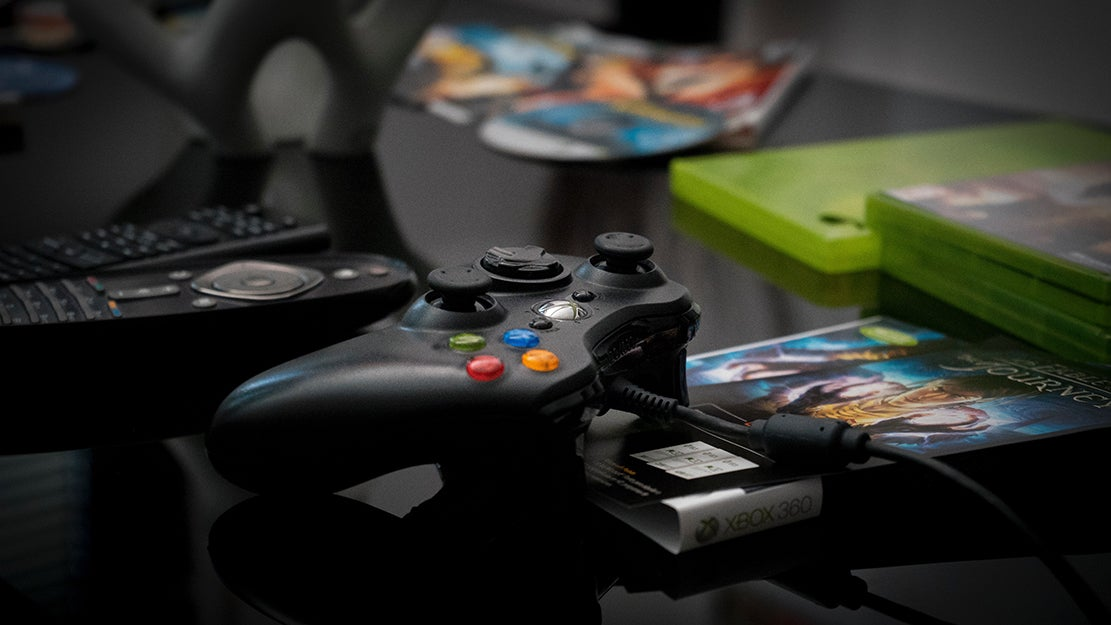 xbox controller and games on a table