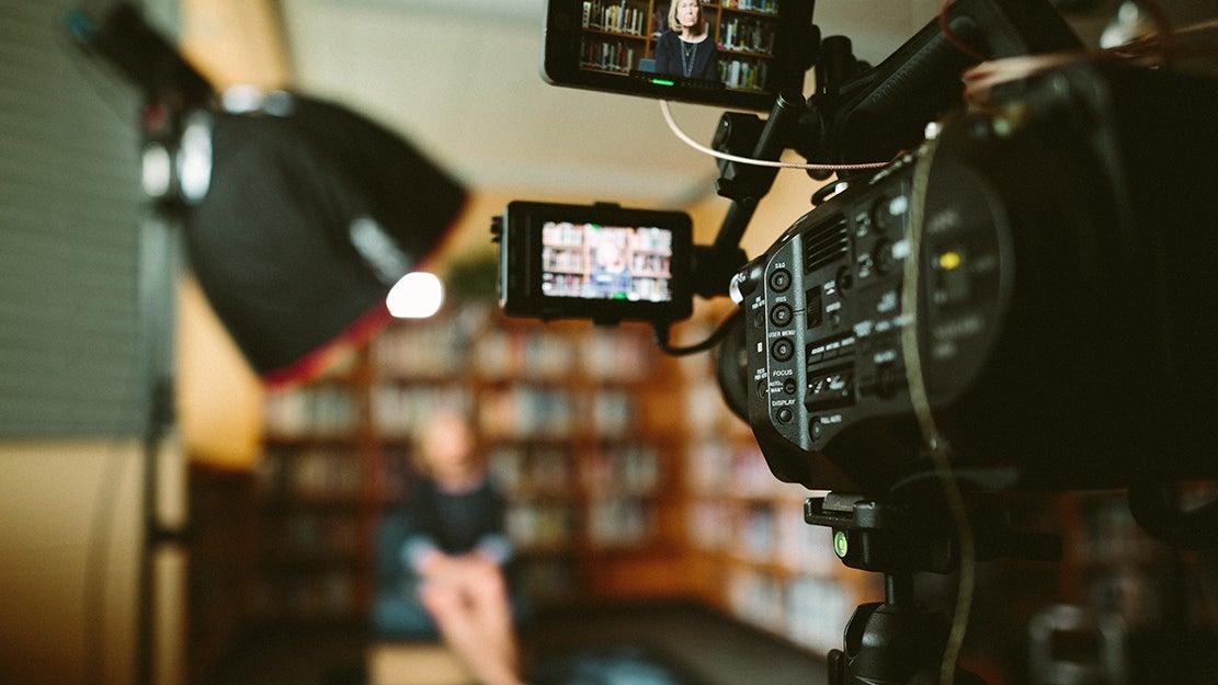 camera filming an interview