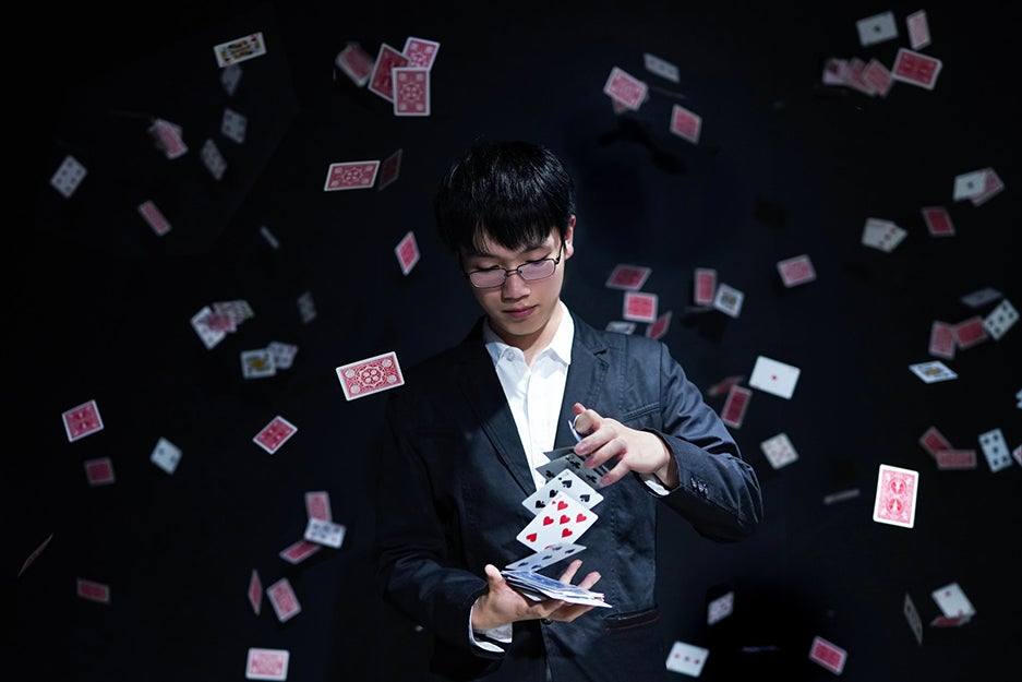 guy playing with cards