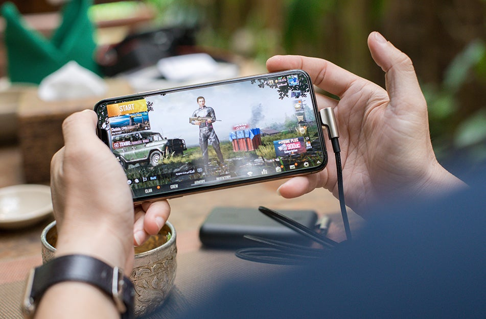 person playing game on phone