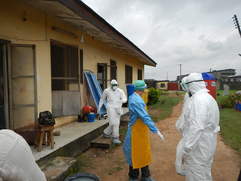 World health organization workers wearing PPE during the Ebola epidemic.