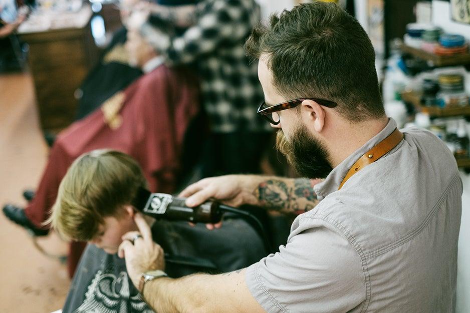 guy giving a kid a haircut