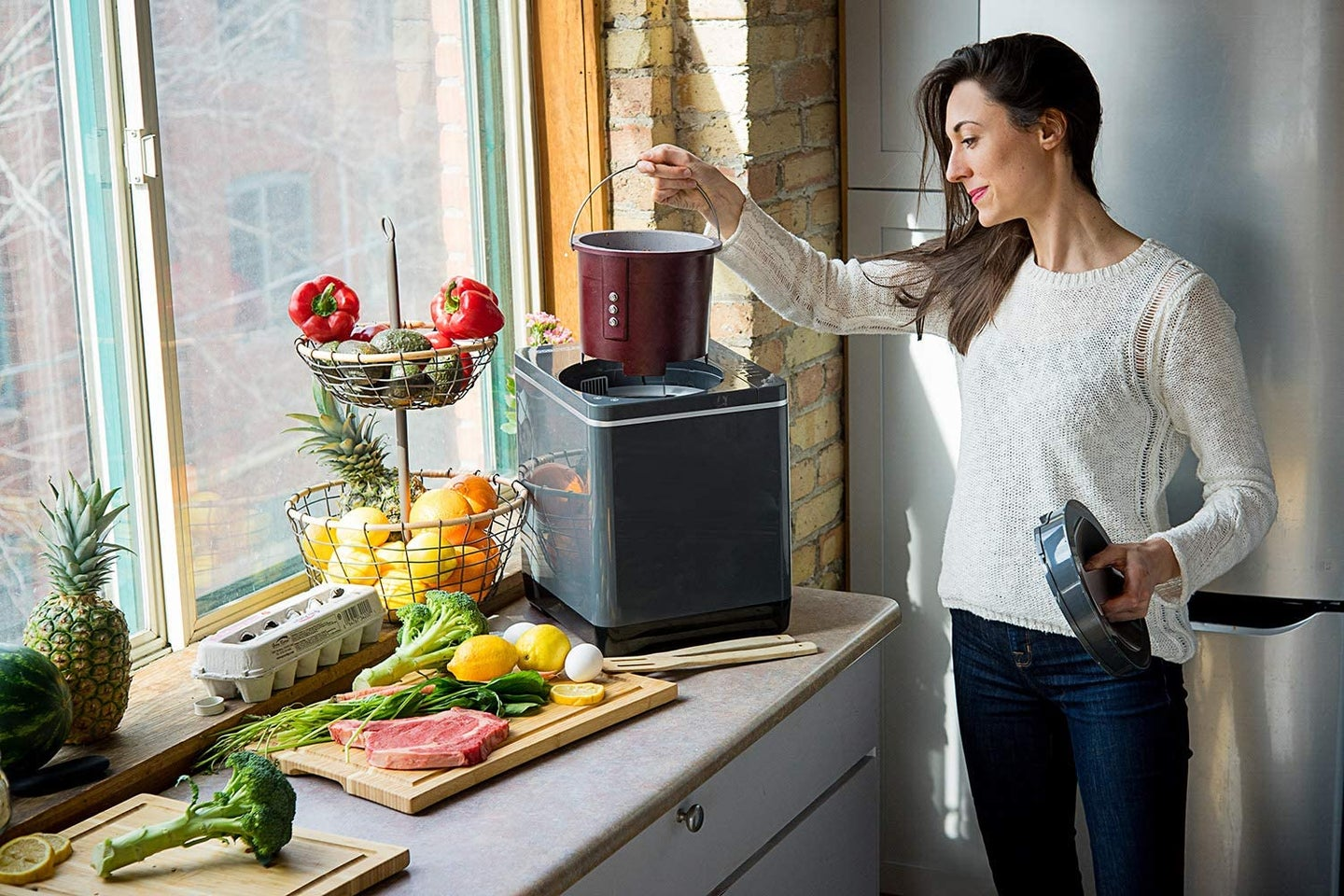 woman using an indoor compost