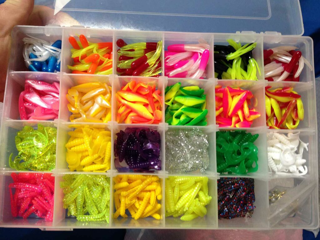 A fishing tackle box full of crappie jigs.