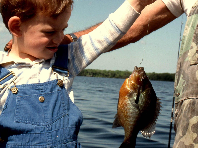 Angler holding up a panfish.