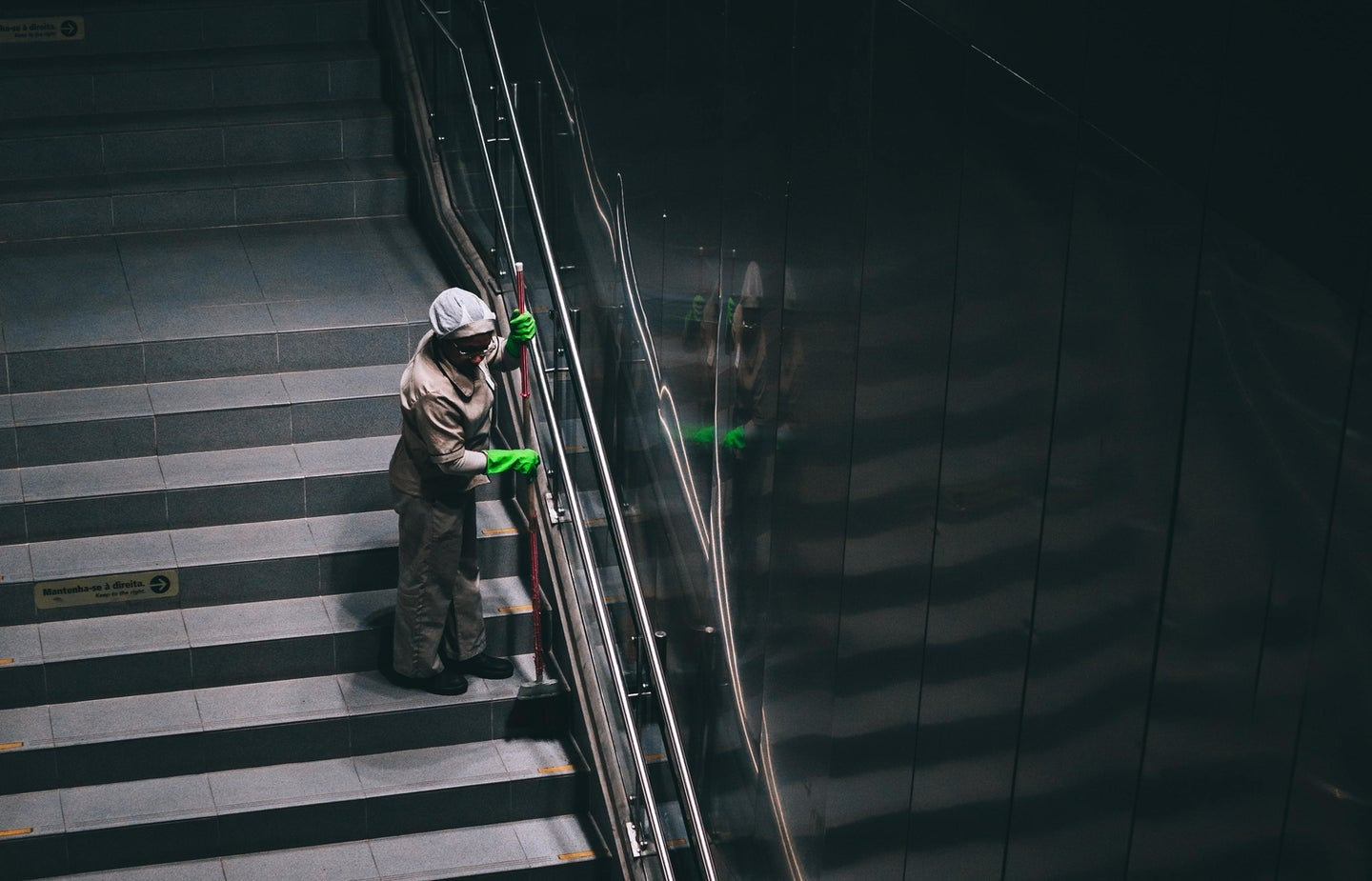 a person cleaning a stairway