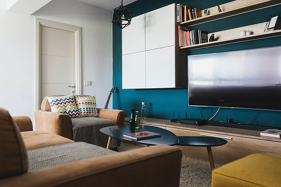 living room with tv and sound bar tv