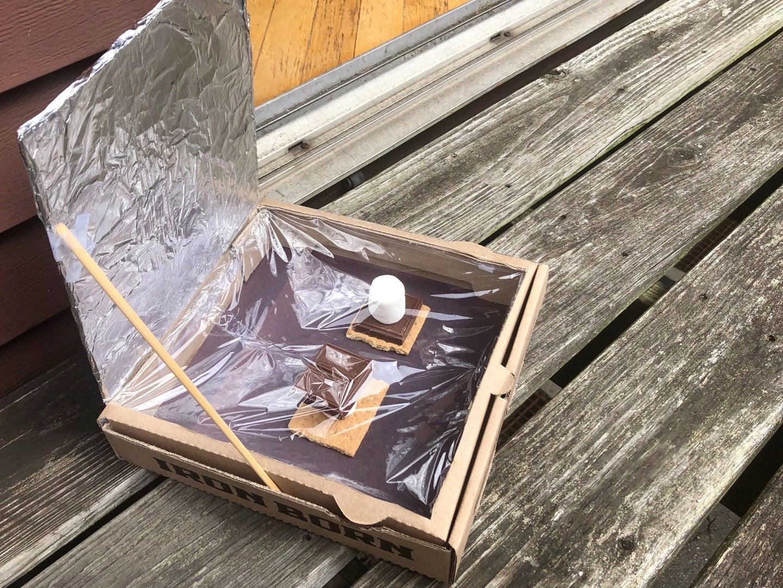 a DIY solar oven baking s'mores