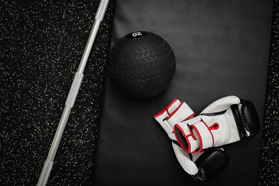 exercise ball and boxing gloves on the ground
