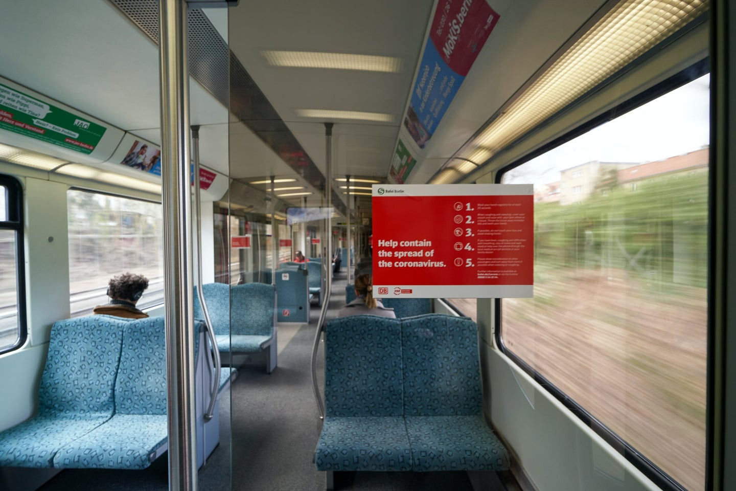 train with sign saying help contain the spread of the coronavirus
