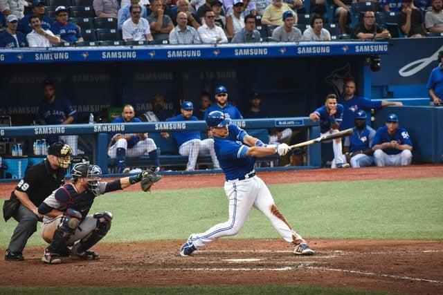 a baseball player swings a bat