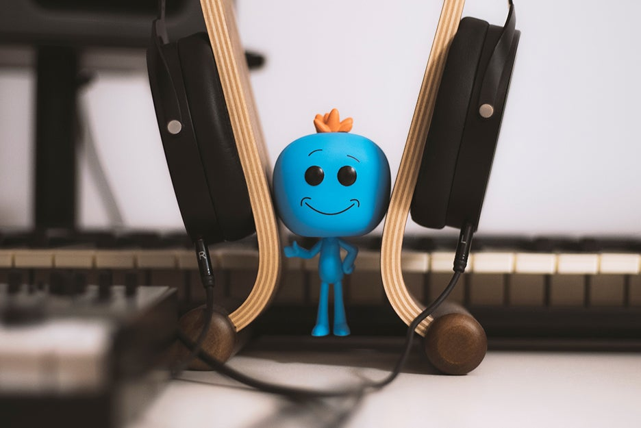 figure with headphones and keyboard