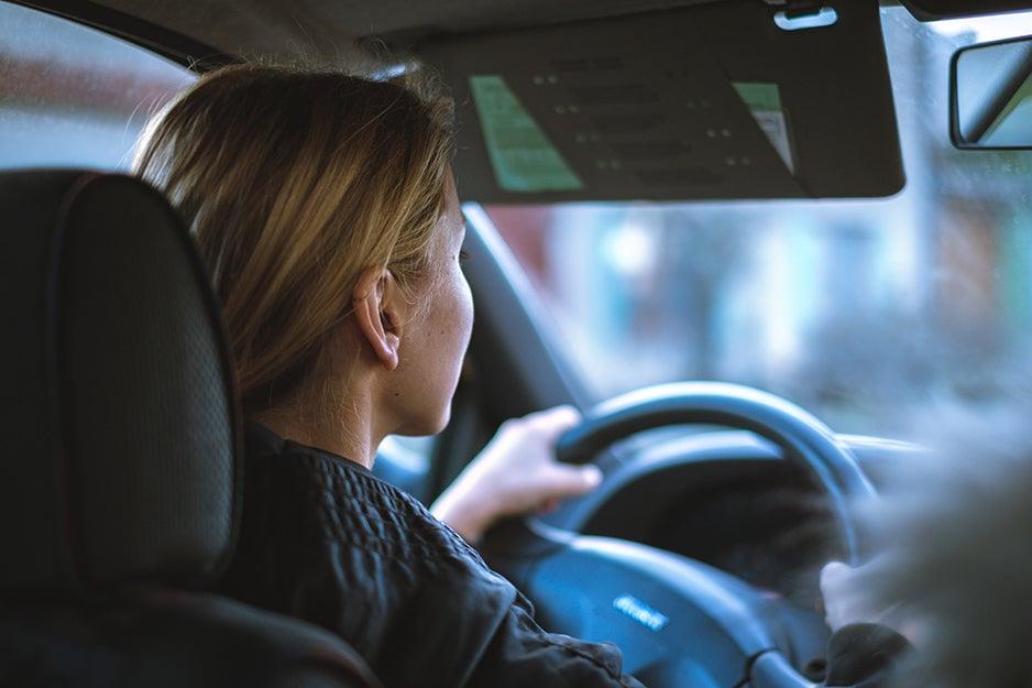 person driving a car