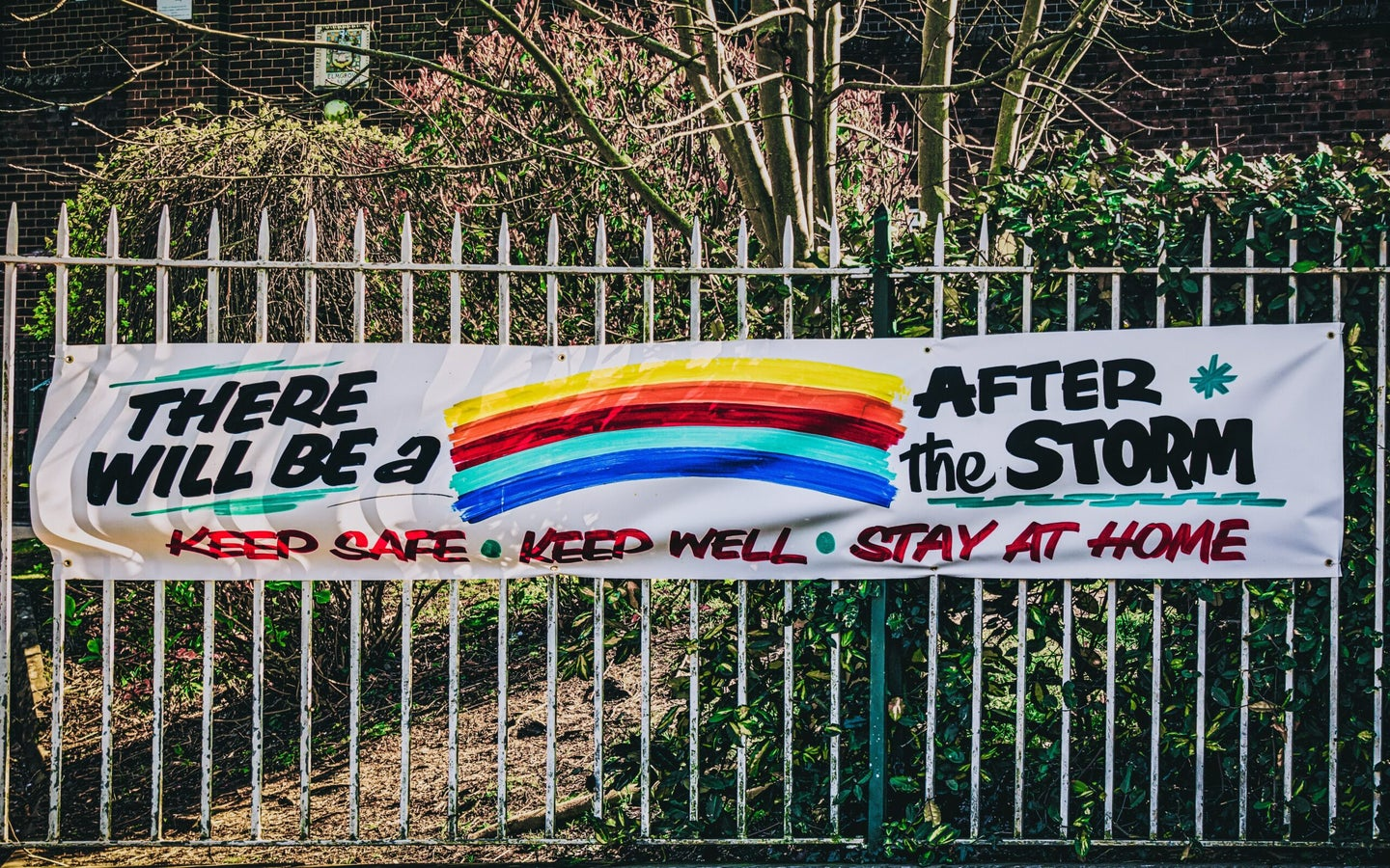 """A school in Belfast, Ireland hangs up a banner that says, """"there will be a storm after the storm."""""""