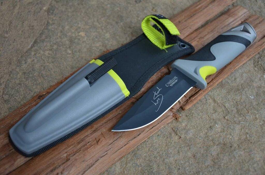 A knife with a hard-shelled sheathe.