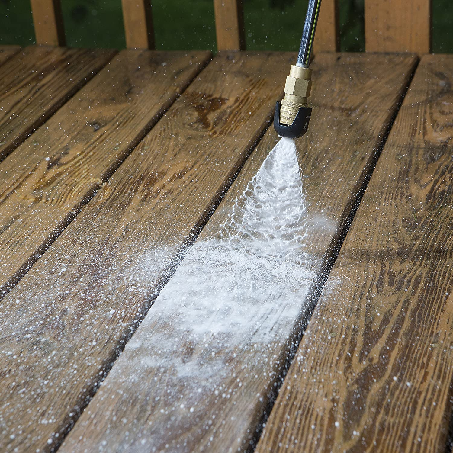 power washer being used on wood