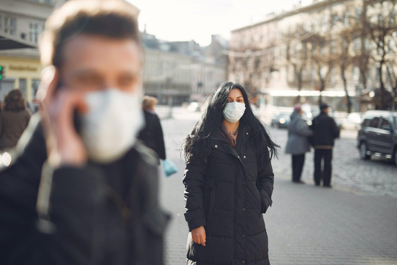 people outside wearing face masks