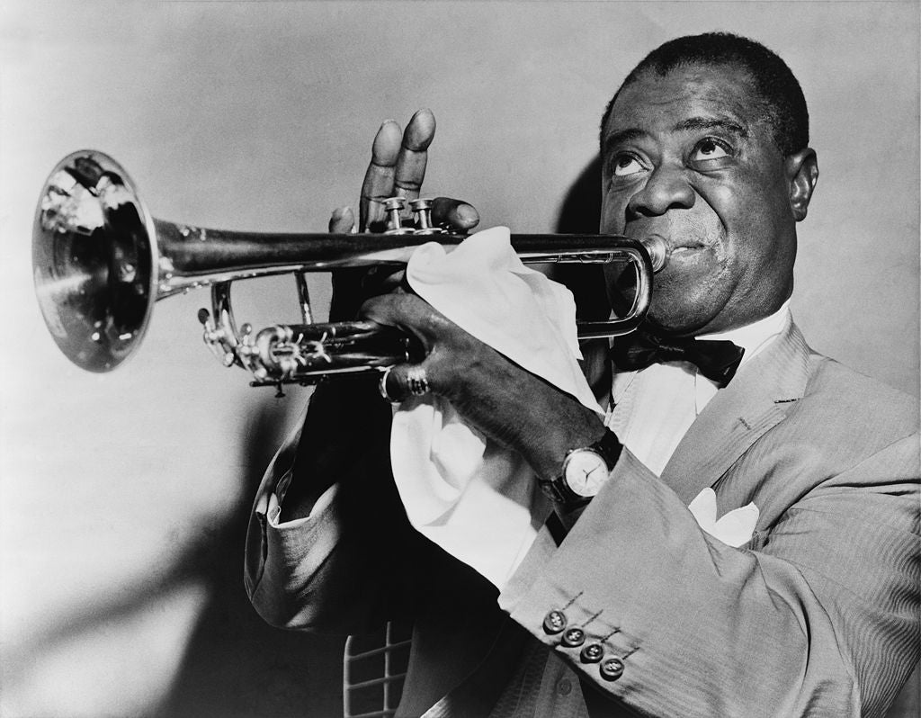Louis Armstrong playing a trumpet