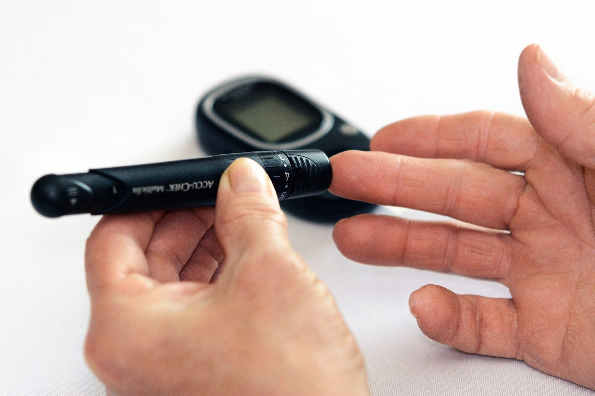 person using diabetes equipment to test their blood sugar