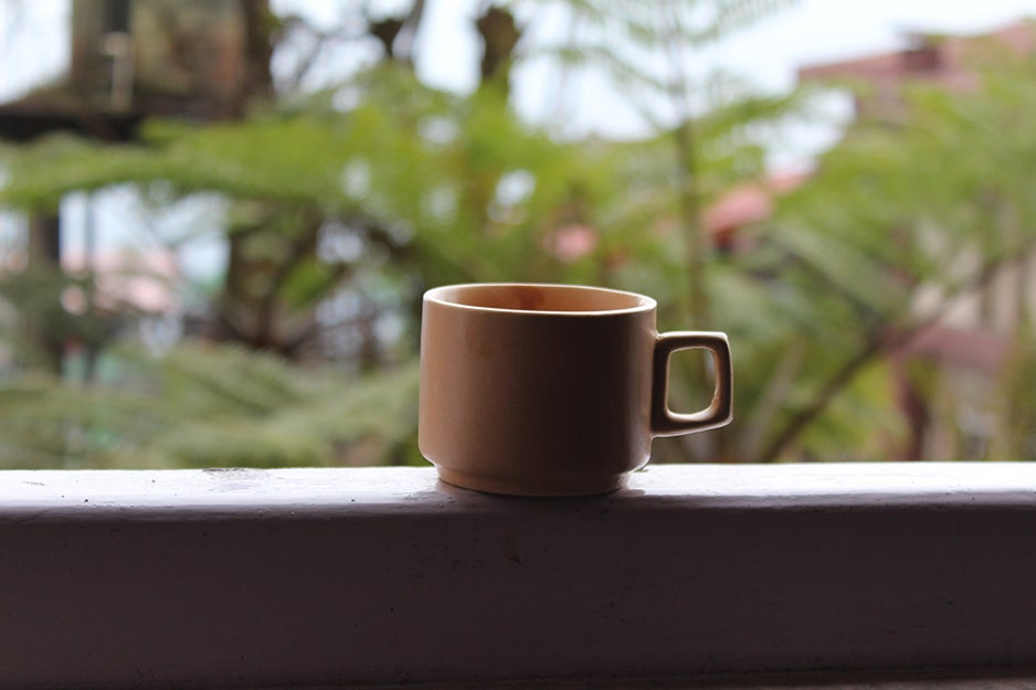 coffee cup on a ledge