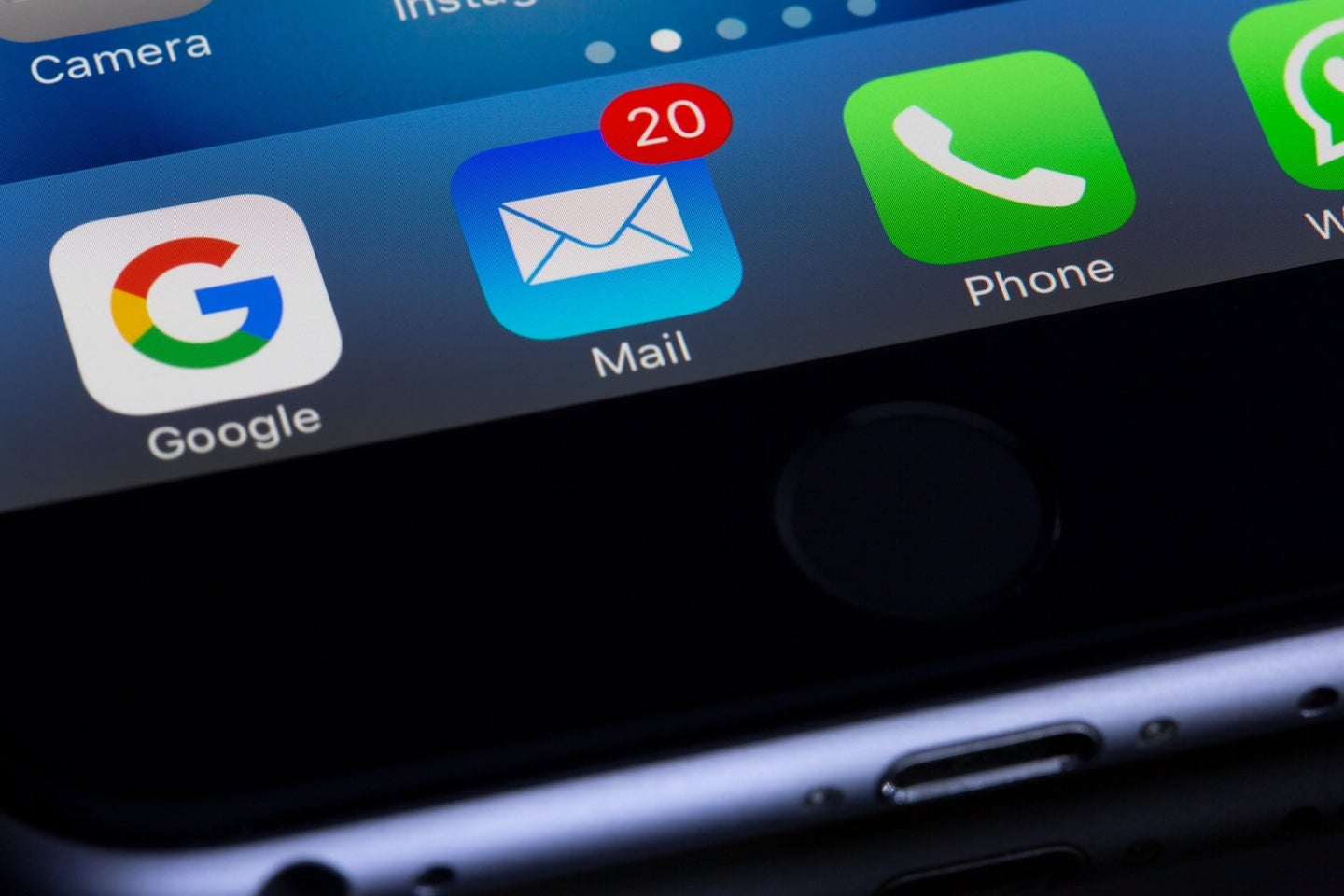 a phone with the Apple Mail app visible, with some notifications