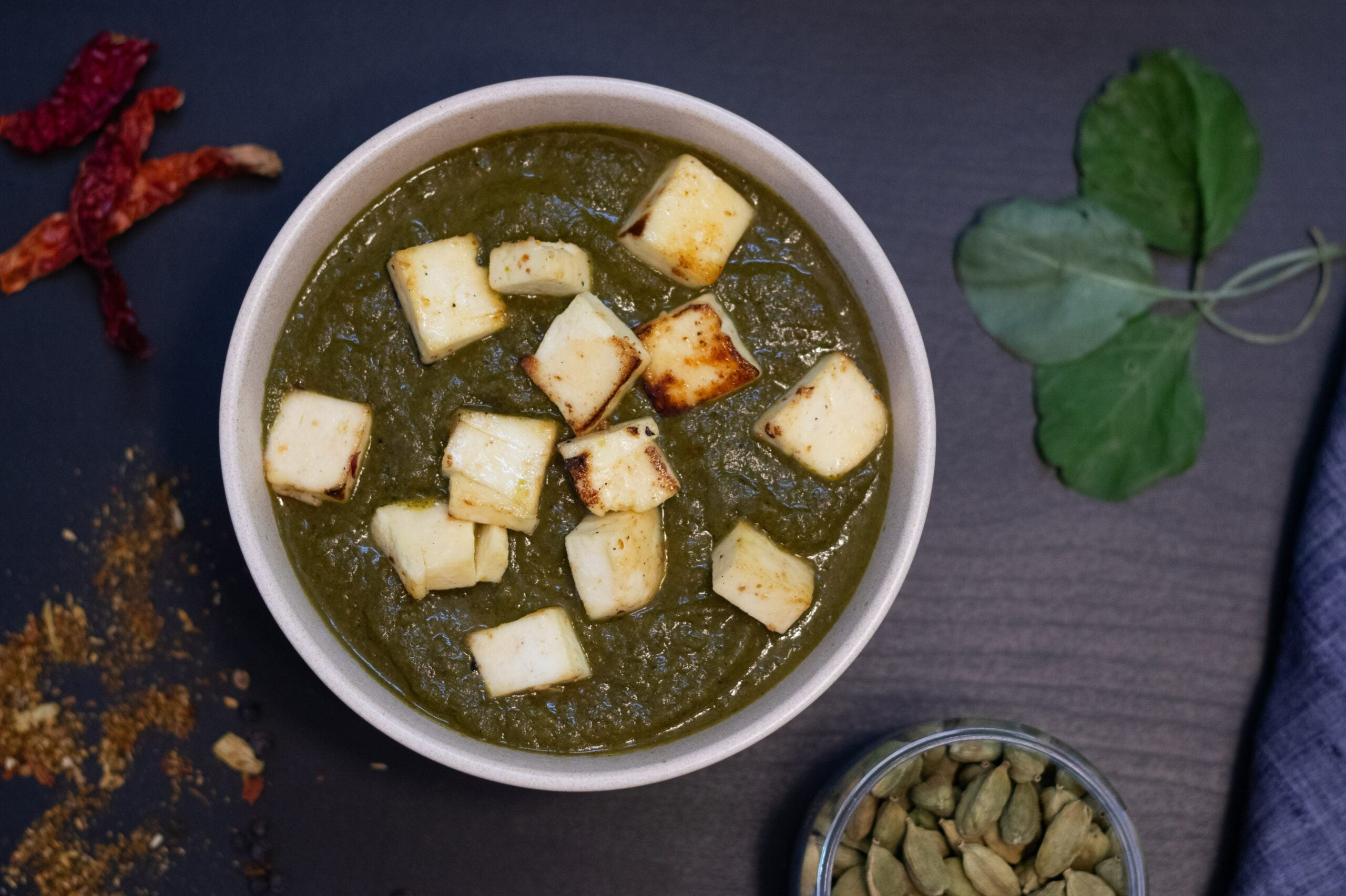 A bowl of saag or spinach paneer