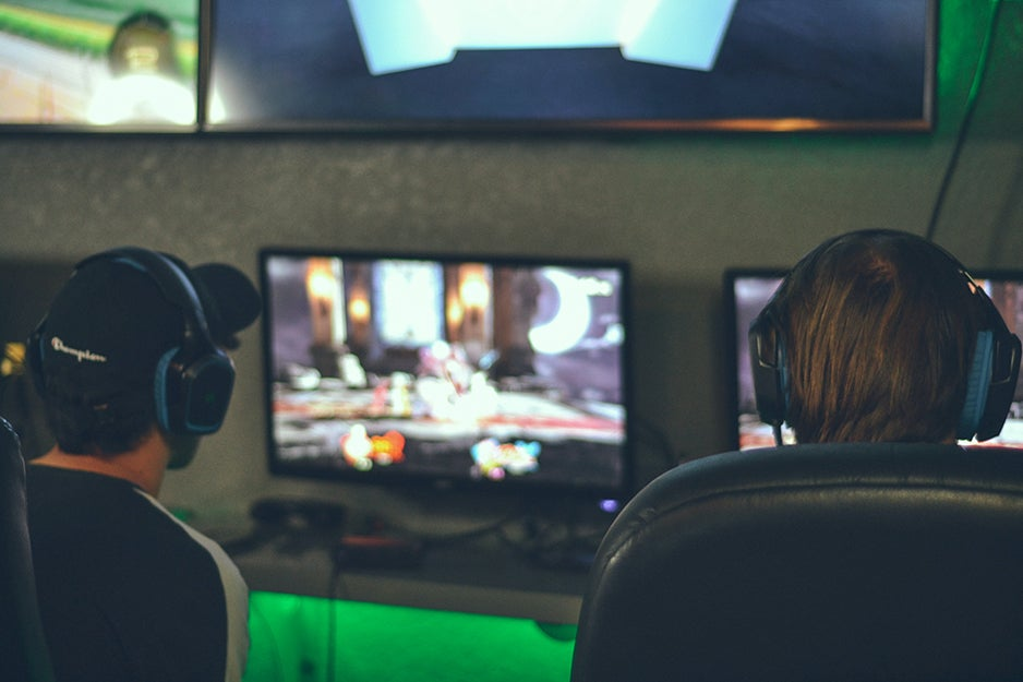 two people playing PC video games