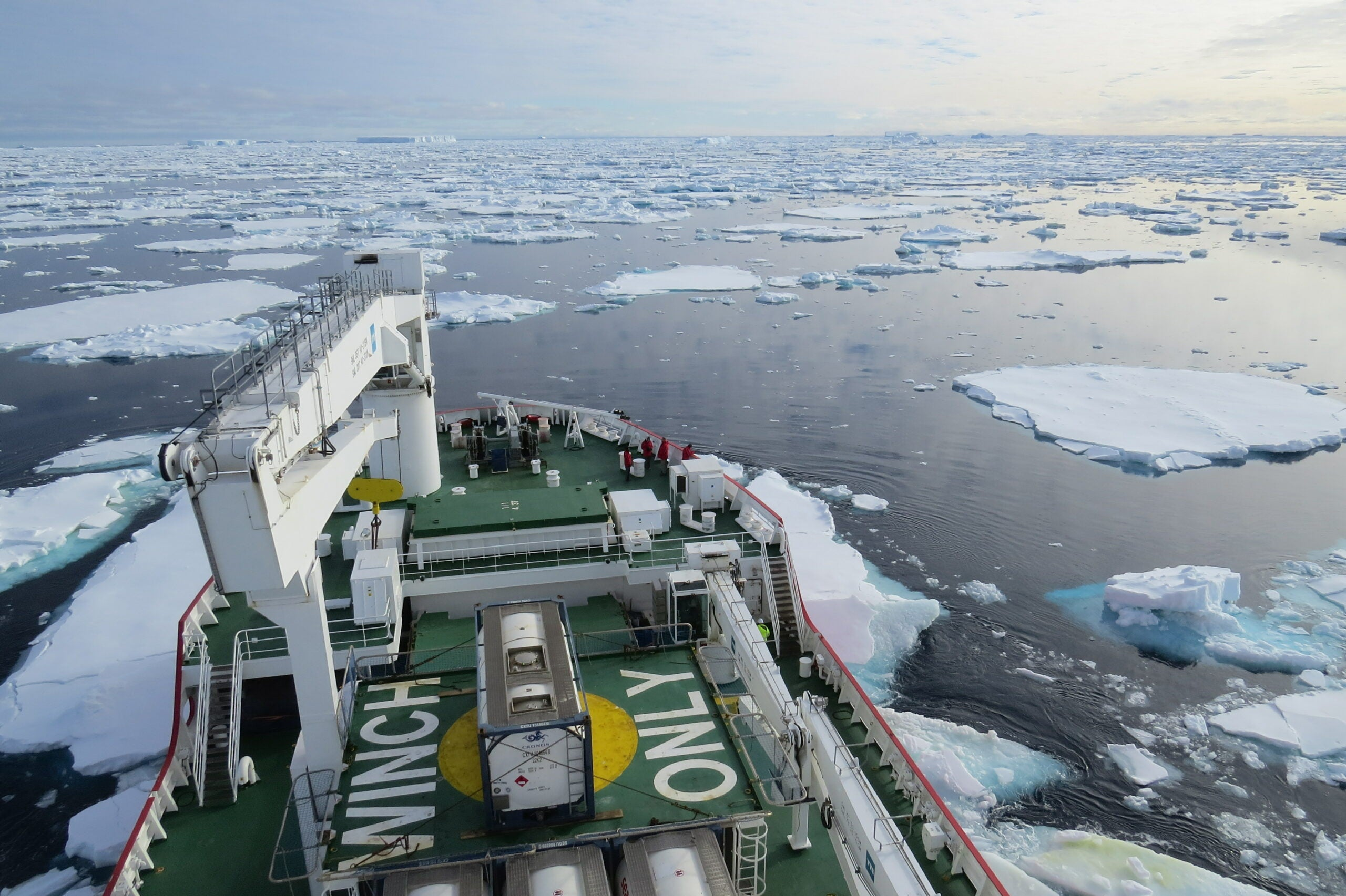ship deck looking over icy water