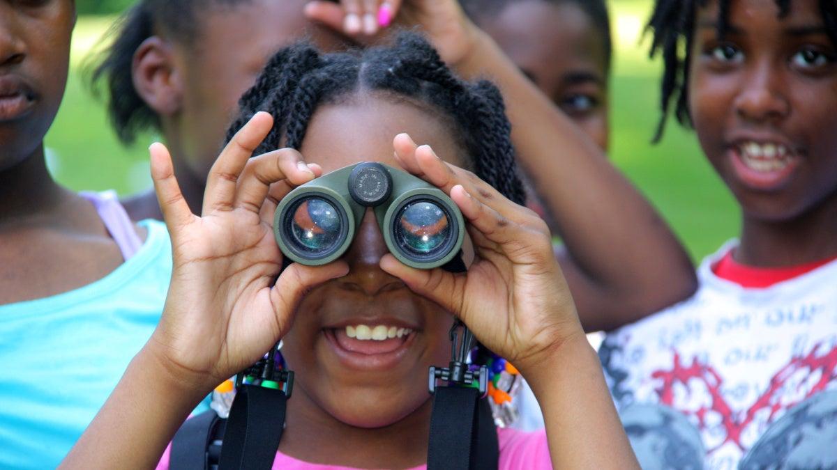 Black kids with binoculars