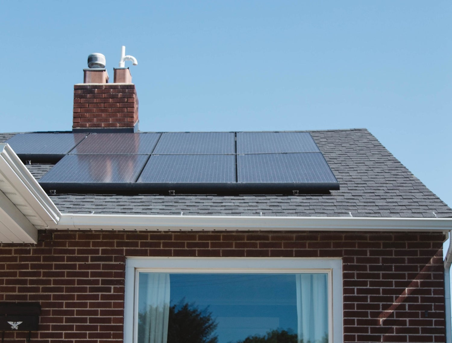 a residential home with solar panels on the roof