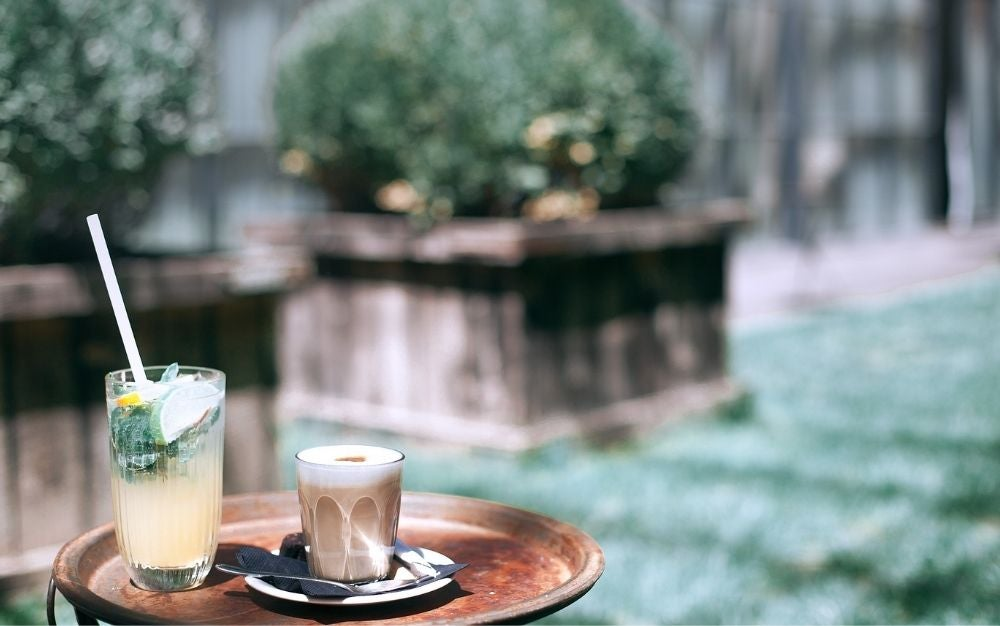 Cold drink and coffee on a tray