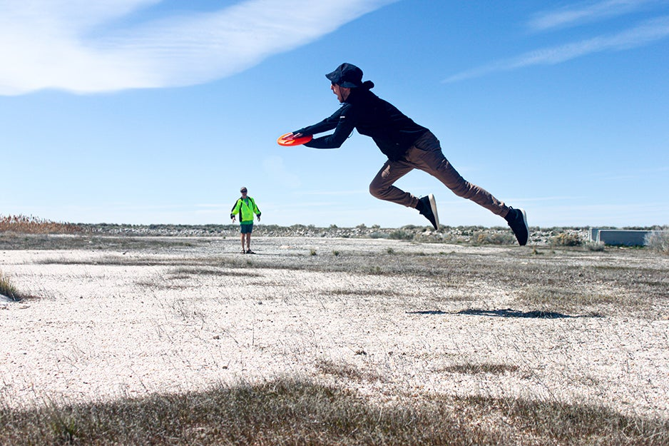 two people playing frisbee