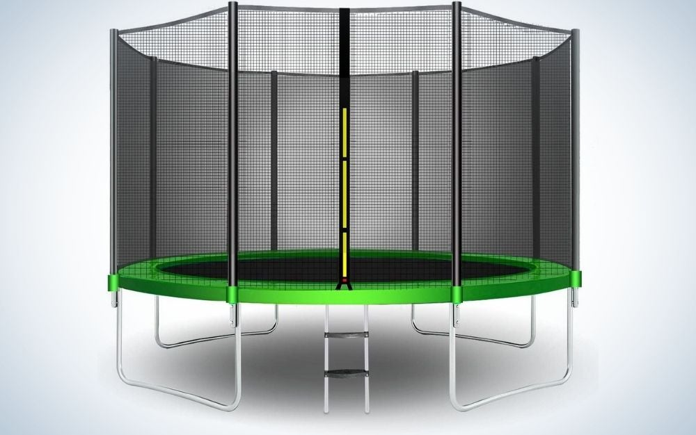 A large black and green trampoline and wrapping translucent nets around it and with metal standing legs under it.