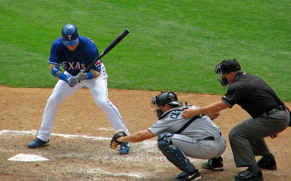 An MLB umpire calls a strike or a ball during a 2019 game.