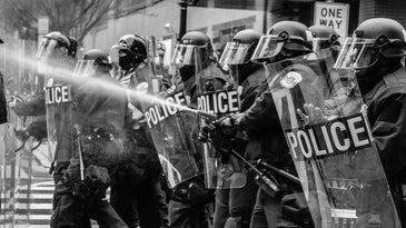 Police spraying pepper spray