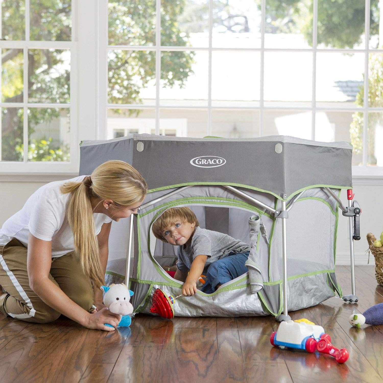 parent and child using playard