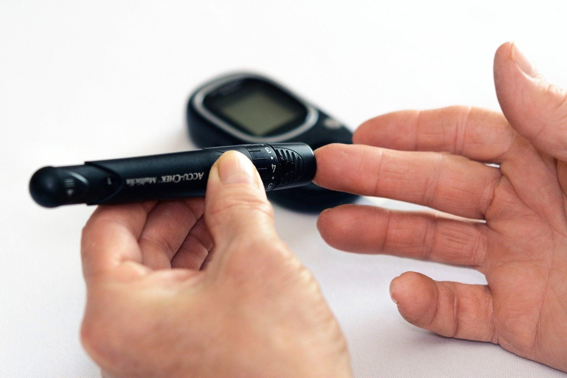 a person checking their blood sugar