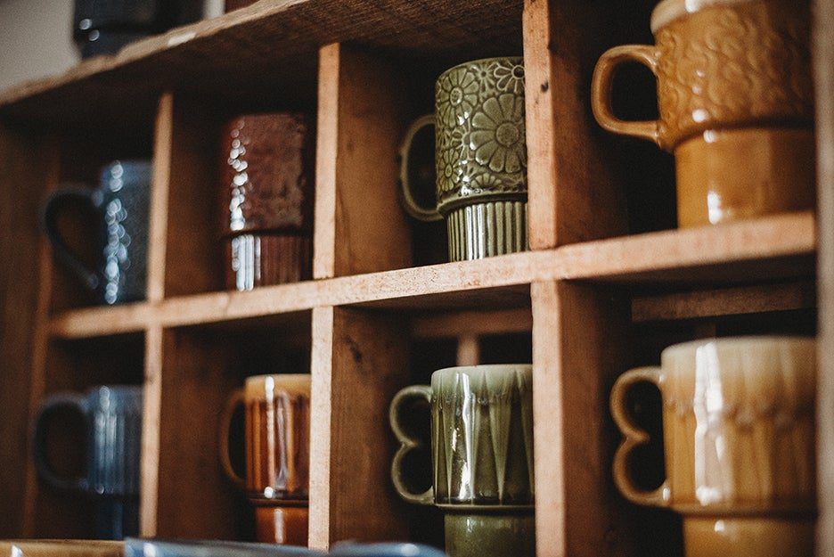 mugs in a case