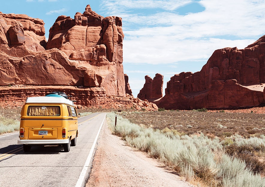 van driving through desert