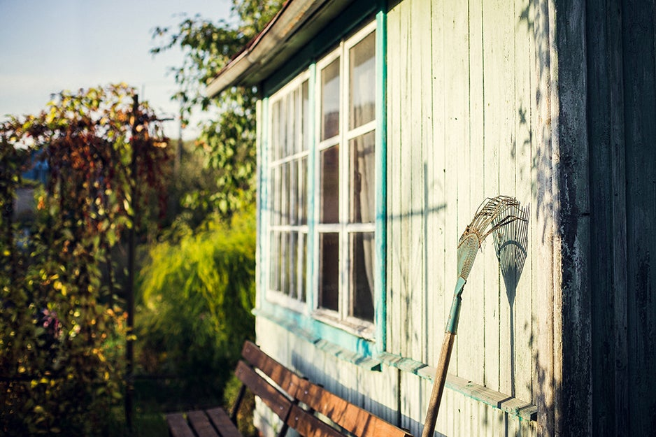 rake leaning against a house