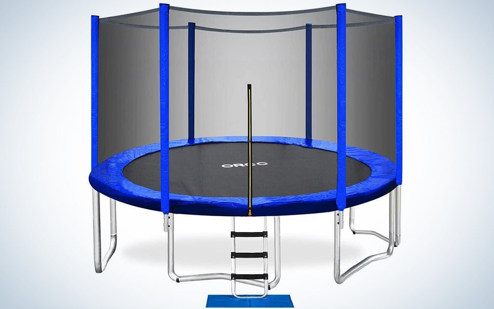 trampoline with a blue mat and pole protectors