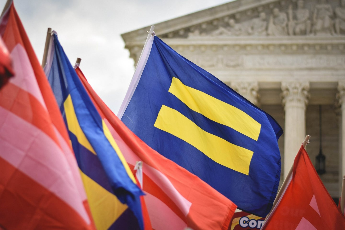 LGBTQIA+ advocates rally in front of the Supreme Court of the United States.