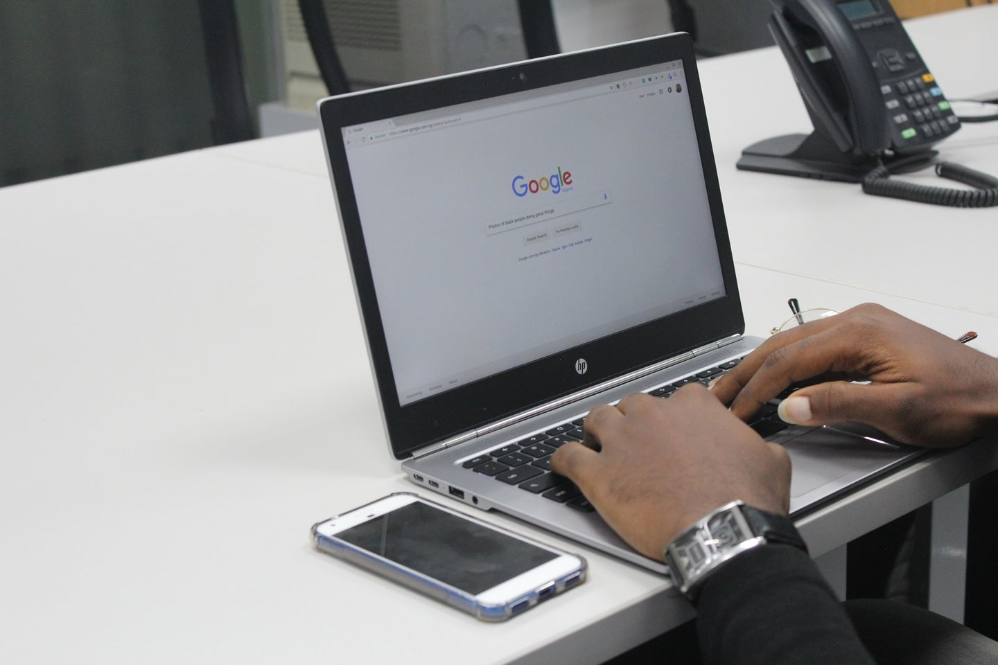 a person using the Google search engine on a laptop