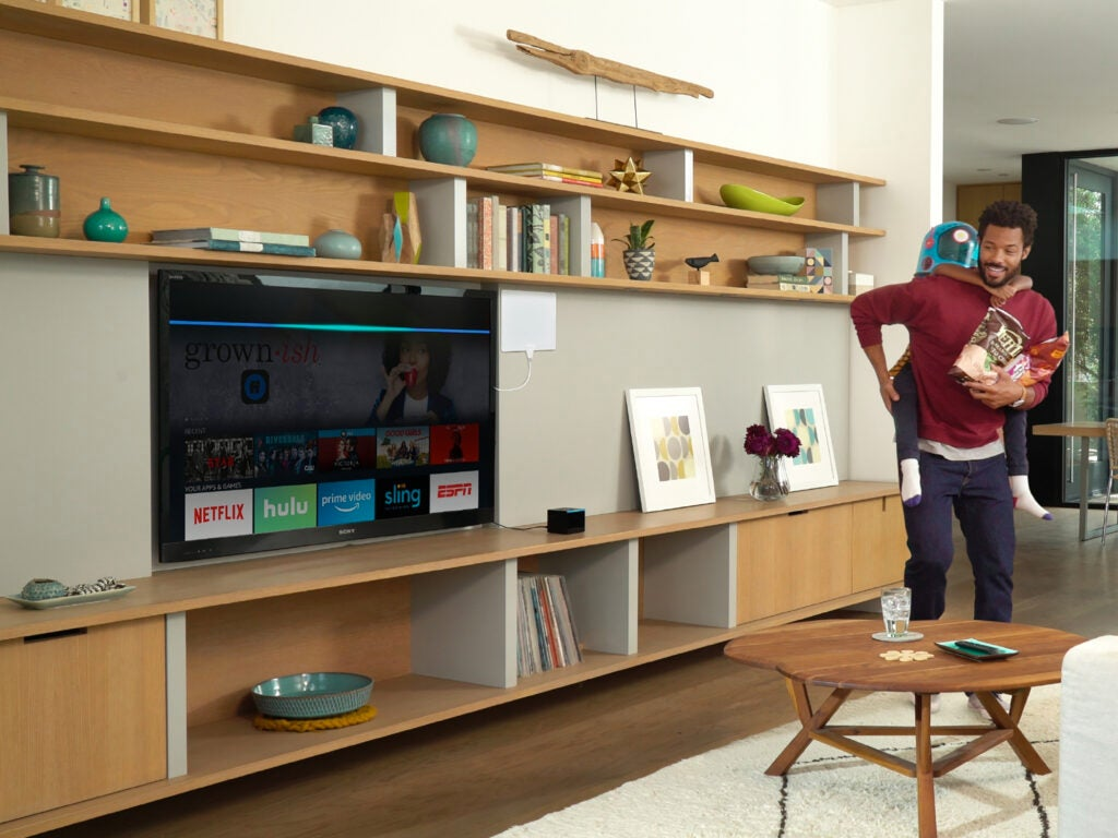 a man and a child near a smart TV