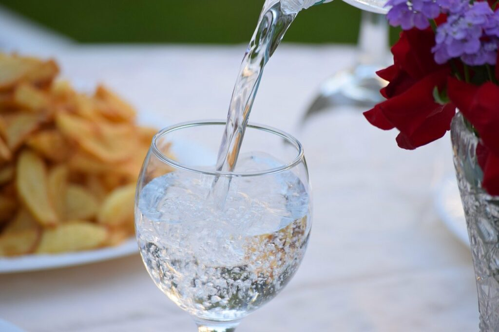 Sparkling water being poured into a glass