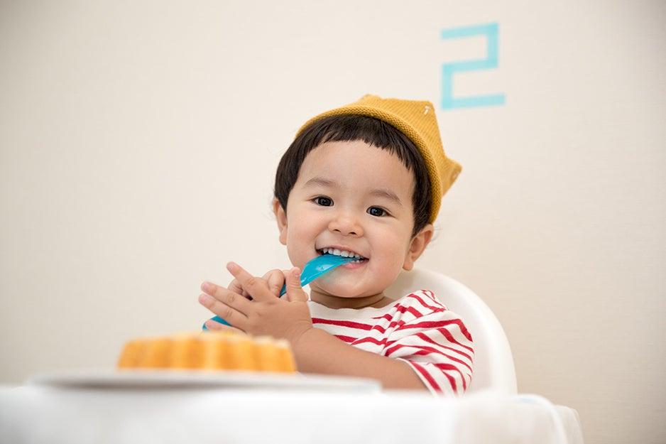 kid eating in a high-chair
